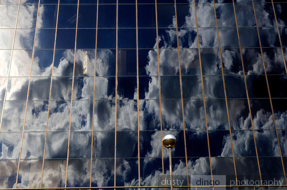 Blue sky and clouds reflected in glass building windows. Perth, Western Australia