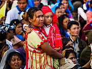 29 NOVEMBER 2017 - YANGON, MYANMAR:  People watch Pope Francis drive the grounds of the Papal Mass in the Pope Mobile. Hundreds of thousands of Catholics from Myanmar attended the mass said by Pope Francis at Kyaikkasan Sports Ground in Yangon Wednesday. Pope Francis is on the first visit by a Pope to Myanmar.   PHOTO BY JACK KURTZ