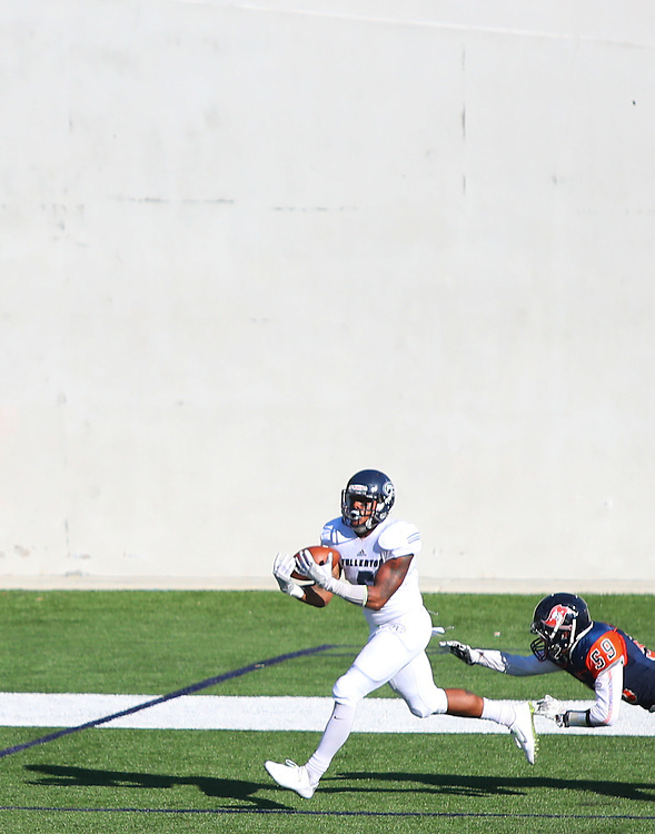 Fullerton College running back Phillip Butler catches a 30-yard pass with 7:39 left in the third quarter of a football game between Fullerton College and Orange Coast College at Lebard Stadium in Costa Mesa, Calif., on Saturday November 5, 2016. This was Butler's third touchdown of the game. (© Kelly Aoki / Sports Shooter Academy 2016)