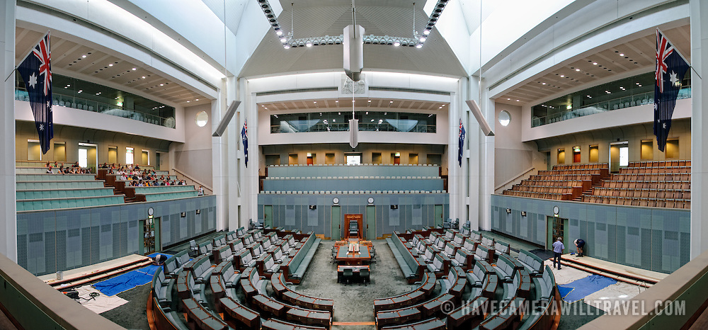 Panoramic shot of the interior of the House of Representatives chamber of Australia's Parliament House.