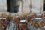 John Paul II Square (Trg Ivana Pavla II) filled with cane chairs and tables. Trogir, Croatia