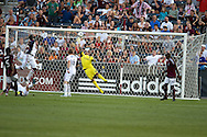 August 4, 2012: Colorado Rapids midfielder Joseph Nane (5) sales a shot over the outstretched hand of Real Salt Lake goalkeeper Nick Rimando (18) for his first MLS goal in the first half at Dick's Sporting Goods Park in Denver, Colorado.  The Rapids would go on to win 1-0