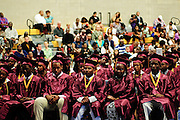 The founding students of Christ the King Jesuit College Preparatory School celebrate their school's First Commencement Exercises with family and staff on Saturday, June 9th 2012. The institution is a beacon of hope amid one of the city's most impoverished neighborhoods, bucking low graduation rate trends with a 100% graduation and college acceptance rate. Brian J. Morowczynski~ViaPhotos..For use in a single edition of Catholic New World Publications, Archdiocese of Chicago. Further use and/or distribution may be negotiated separately. ..Contact ViaPhotos at 708-602-0449 or email brian@viaphotos.com.