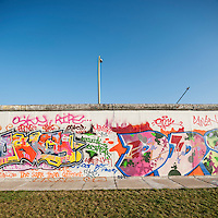 Grafiti covered section of Berlin Wall, back side of East Side Gallery, Berlin, Germany