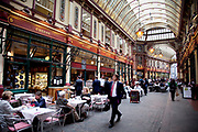 City workers and business people in Leadenhall Market in the City of London. Located in Gracechurch Street, the market dates back to the fourteenth century. There are cheesemongers, butchers and florists. Originally a meat, game and poultry market, it stands on what was the centre of Roman London. Designed in 1881 by Sir Horace Jones.