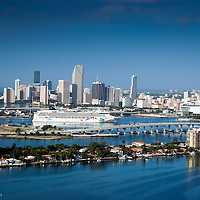Aerial photo of cruise ship arriving to the Port of Miami with Venetian Causeway in foreground.