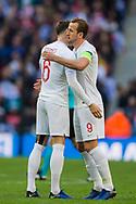 Harry Kane (Capt) (England) hugs John Stones (England) prior to the UEFA Nations League match between England and Croatia at Wembley Stadium, London, England on 18 November 2018.