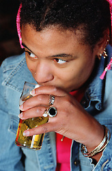 Young woman with Cerebral Palsy drinking pint of beer,