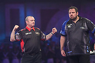 Darren Webster hits a double and wins a leg during the PDC William Hill World Darts Championship at Alexandra Palace, London, United Kingdom on 23 December 2019.