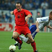 Belgium's Yves Vanderhaeghe comes away from Japan's Koji Nakata