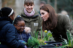 The Duchess of Cambridge speaks with children during a visit to the King Henry's Walk Garden in Islington, London to learn about a project bringing people together through a shared love of horticulture.
