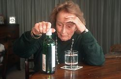Elderly woman drinking alcohol,