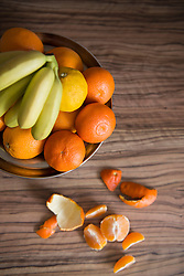 High angle view of fruit bowl of oranges and bananas on table, Munich, Bavaria, Germany
