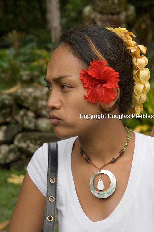 Woman at Meae Iipona, Puamau, Hiva Oa, Marquesas Islands, French Polynesia, (Editorial use only)<br />