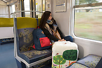 Young woman on her way home to Singapore, RER B.