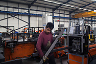 Umit, an employee at the Somcelik factory in Kayseri, Turkey, where shelving, storage supplies and supermarket fittings are manufactured.