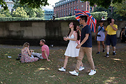 As heatwave temperatures climb to record levels - the hottest day of the year so far - Londoners and visitrs stick to the shade in the City of London the capitals financial district aka the Square Mile, on 25th July 2019, in London, England.