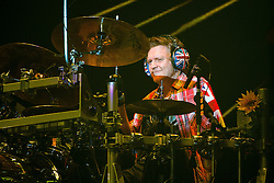 © Licensed to London News Pictures . 15/12/2015 . Manchester , UK . RICK ALLEN . Def Leppard perform at the Manchester Arena . Photo credit : LNP