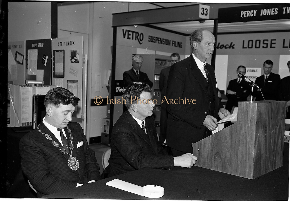09/03/1964<br /> 03/09/1964<br /> 09 March 1964<br /> Office Productivity Exhibition in Dublin. The exhibition sponsored by the Dublin Junior Chamber of Commerce was opened by Mr Jack Lynch, Minister for Industry and Commerce at the Intercontinental Hotel, Dublin. Picture shows Jack Lynch speaking at the opening. Also in the photograph is Mr Jack Fallon (left) President Dublin Junior Chamber of Commerce and Mr Liam Keegan, Chairman, Organising Committee.