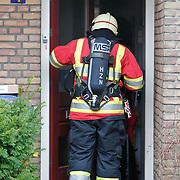 NLD/Amsterdam/20101026 - Woningbrand Hyacintstraat Huizen