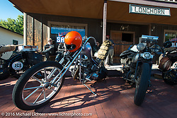 Bill Buckingham's 1923 Harley-Davidson J model custom chopper (that won top honors at Born Free 6) parked at the Longhorn Saloon at the Old Town Museum in Burlington, Colorado for the hosted dinner stop during Stage 8 of the Motorcycle Cannonball Cross-Country Endurance Run, which on this day ran from Junction City, KS to Burlington, CO., USA. Saturday, September 13, 2014.  Photography ©2014 Michael Lichter.