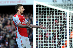 Arsenal's Olivier Giroud spurs on the Arsenal fans before he scores a goal to put Arsenal 1-0 up - Photo mandatory by-line: Dougie Allward/JMP - Mobile: 07966 386802 - 01/03/2015 - SPORT - football - London - Emirates Stadium - Arsenal v Everton - Barclays Premier League