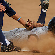 4/26/12 1:17:21 PM --- BASEBALL SPORTS SHOOTER ACADEMY 009 ---Catcher Eric Peruzzi (10) of Irvine Valley College safely slides into third base under the tag from third baseman Austin Wobrock (7) of Orange Coast College on Thursday, April 26, 2012 in Costa Mesa, Calif.  Orange Coast College won 5 to 2.  Photo by Michael Yanow, Sports Shooter Academy