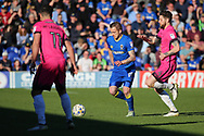AFC Wimbledon midfielder Dean Parrett (18) dribbling and taking on Southend United midfielder Anthony Wordsworth (4) during the EFL Sky Bet League 1 match between AFC Wimbledon and Southend United at the Cherry Red Records Stadium, Kingston, England on 25 March 2017. Photo by Matthew Redman.
