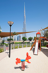 Burj Khalifa tower seen from childrens' play park in Dubai United Arab Emirates