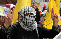 April 17, 2018 - Gaza, Palestinian Territories, Palestine - A Palestinian woman wearing the traditional Palestinian keffiyeh scarf takes part in a demonstration in Gaza City in support of Palestinian prisoners held in Israeli jails. (Credit Image: © Majdi Fathi/NurPhoto via ZUMA Press)