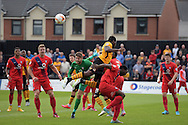 Scott Flinders , the York city goalkeeper saves from Newport's Lenell John-Lewis. Skybet football league two match, Newport county v York city at Rodney Parade in Newport, South Wales on Saturday 5th Sept 2015.  pic by Andrew Orchard, Andrew Orchard sports photography.