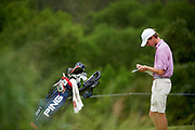 Matthew Riedel writes down his score during the Under Armour® / Jordan Spieth Championship presented by American Campus Communities at Trinity Forest Golf Club in Dallas, Texas on August 15, 2017. CREDIT: Cooper Neill for The Wall Street Journal<br /> JRGOLF