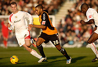Photo: Leigh Quinnell.<br /> Milton Keynes Dons v Barnet. Coca Cola League 2. 20/01/2007. Barnets Jason Puncheon gets past MK Dons Aaron Wilbraham.