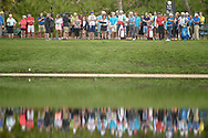 Rory McIlroy, right, of Northern Ireland, watches his tee shot on the 12th hole during the second round of the Arnold Palmer Invitational golf tournament in Orlando, Fla., Friday, March 18, 2016. (AP Photo/Phelan M. Ebenhack)