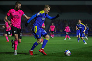 AFC Wimbledon striker Joe Pigott (39) dribbling andbattles for possession with Peterborough United defender Mark Beevers (5) during the EFL Sky Bet League 1 match between AFC Wimbledon and Peterborough United at Plough Lane, London, United Kingdom on 2 December 2020.