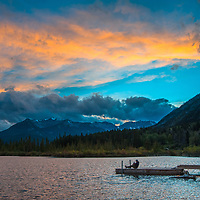 A photographer shoots a sunset over the Canadian Rockies and  Vermillion Lakes in Banff National Park, Alberta, Canada.