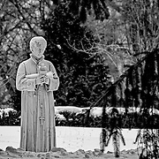 This statue at the Loyola Jesuit Center in Morristown, NJ was sitting in a very quiet spot where it conveys the quiet and spirituality of the center.  On the day that I took this picture, it was very cold with a new layer of snow.  I love how the black and white brings out the contrast of the snow and gives a chilling view.