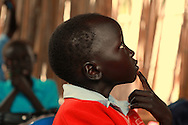 Children at the Little Angels study in Bor, Sudan on Wednesday, October 20, 2010. The students receive World Food Program fortified porridge and lunch each day that is distributed by CRS. Almost 50 percent of children under five living in south Sudan suffer from malnutrition.