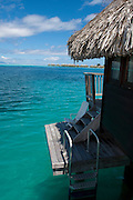 Overwater bungalows on stilts at a resort hotel, Bora Bora, French Polynesia