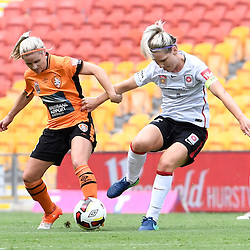 BRISBANE, AUSTRALIA - JANUARY 7: Caitlin Cooper of the Wanderers and Amy Chapman of the Roar compete for the ball during the round 11 Westfield W-League match between the Brisbane Roar and Western Sydney Wanderers at Suncorp Stadium on January 7, 2017 in Brisbane, Australia. (Photo by Patrick Kearney/Brisbane Roar)
