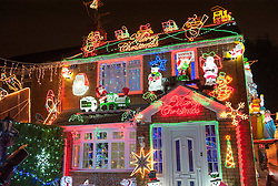 © Licensed to London News Pictures. 01/12/2015. Bristol, UK.  The Brailsford family's Christmas Lights Big Switch On. Brothers Lee and Paul Brailsford have spent 20 years and more than £20,000 building up their huge collection of festive decorations in Bentry, Bristol to turn the home of their mother Rosemary into a winter wonderland every year. They have tens of thousands of lights, a life-size nativity, trains, snowmen, toy soldiers, reindeers, Santas and a snow machine. They raise money from people who flock to see the spectacle and to date they have raised more than £30,000 for charities such as the Wallace and Gromit Appeal that supports Bristol Children's Hospital.  The electricity and replacement lights cost around £1,000 each year, but this year the brothers are trying to convert everything to LED lights to be more efficient for Bristol's year as European Green capital 2015. Photo credit : Simon Chapman/LNP