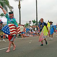 USA, United States, America. The Ocean Beach Geriatric Surf Club leads the Coronado 4th of July Parade.
