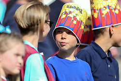 14 May 2017 - Premier League Football - West Ham United v Liverpool - A young fan wears an empty popcorn bucket on his head - Photo: Charlotte Wilson
