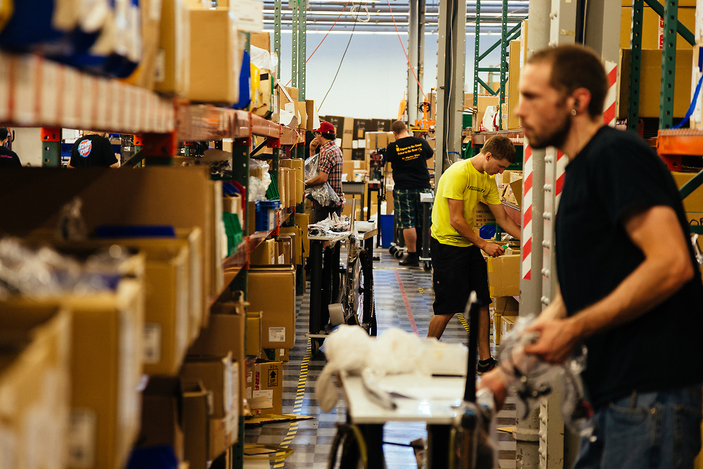 Employees pull parts for the bicycle assembly line,