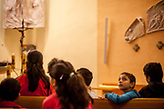 Young Roma inhabitants from Lunik IX joining a church service at the pastoral centre of the Salesians of Don Bosco mission at Lunik IX in Kosice.