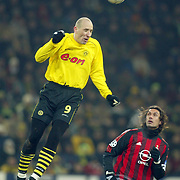 Borussia Dortmund's Jan Koller towers over AC Milan's Paolo Maldini
