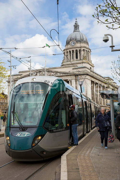 A Nottingham Express Transit NET tram outside Old Market Square in Nottingham, Nottinghamshire, United Kingdom. The tram network in Nottingham has 51 stops and provides an alternative, more sustainable mode of transport for commuters and tourists.
