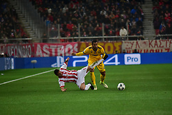 December 5, 2017 - Athens, Attiki, Greece - Uros Djurdjevic (no 9) of Olympiacos and Medhi Benatia (no 4) of Juventus, vies for the ball. (Credit Image: © Dimitrios Karvountzis/Pacific Press via ZUMA Wire)