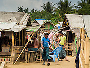 07 NOVEMBER 2014 - SITTWE, RAKHINE, MYANMAR: A street scene in an IDP camp for Rohingya Muslims. After sectarian violence devastated Rohingya communities and left hundreds of Rohingya dead in 2012, the government of Myanmar forced more than 140,000 Rohingya Muslims who used to live in and around Sittwe, Myanmar, into squalid Internal Displaced Persons camps. The government says the Rohingya are not Burmese citizens, that they are illegal immigrants from Bangladesh. The Bangladesh government says the Rohingya are Burmese and the Rohingya insist that they have lived in Burma for generations. The camps are about 20 minutes from Sittwe but the Rohingya who live in the camps are not allowed to leave without government permission. They are not allowed to work outside the camps, they are not allowed to go to Sittwe to use the hospital, go to school or do business. The camps have no electricity. Water is delivered through community wells. There are small schools funded by NOGs in the camps and a few private clinics but medical care is costly and not reliable.   PHOTO BY JACK KURTZ