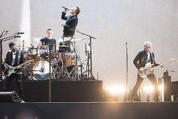 © Licensed to London News Pictures. 10/07/2017. Twickenham Stadium, London, UK. U2 perform during their Joshua Tree Tour 2017. Band members include Bono, The Edge, Adam Clayton, Larry Mullen Jr.  Photo credit: Andy Sturmey/LNP